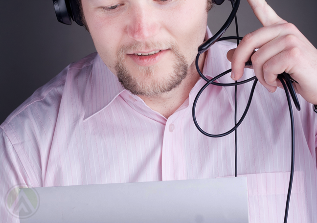 male-call-center-agent-reading-from-paper