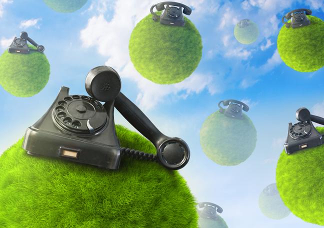 landline phone on small grassy planets