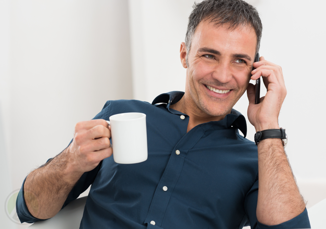 man-with-coffee-enjoying-conversation-over-phone