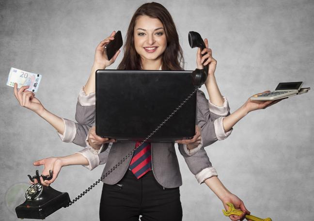 multitasking businesswoman using laptop
