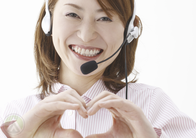 smiling-asian-call-center-agent-forming-heart-with-hands