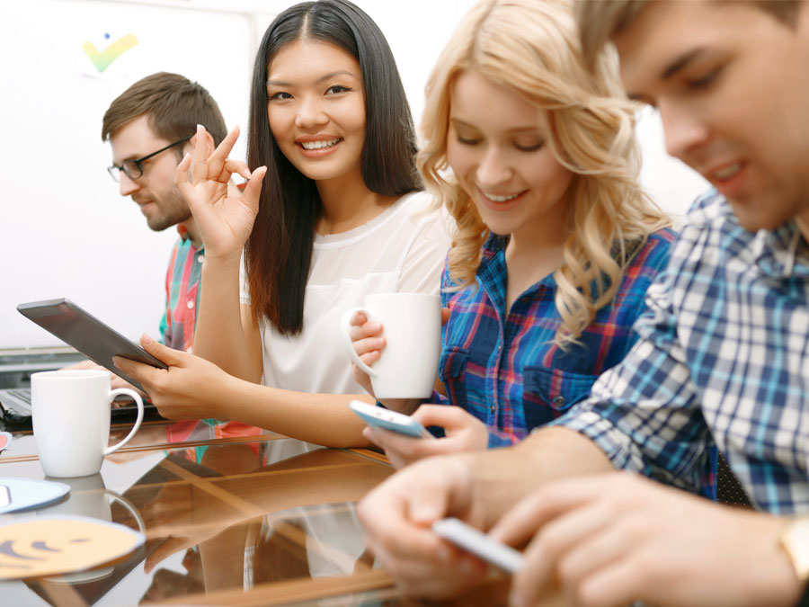 young consumers using laptop smartphone tablet