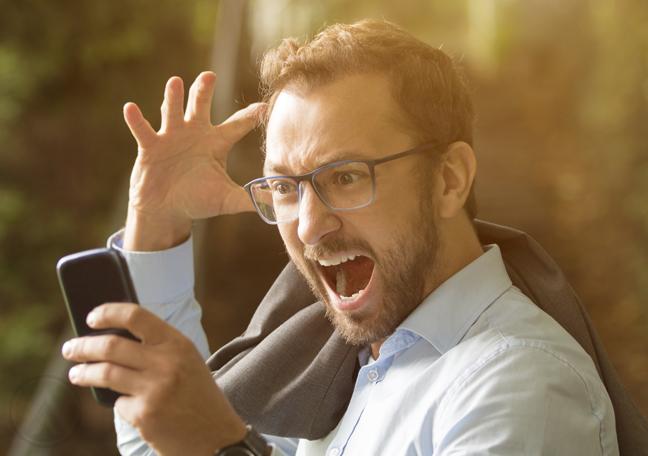 angry asian man screaming at phone