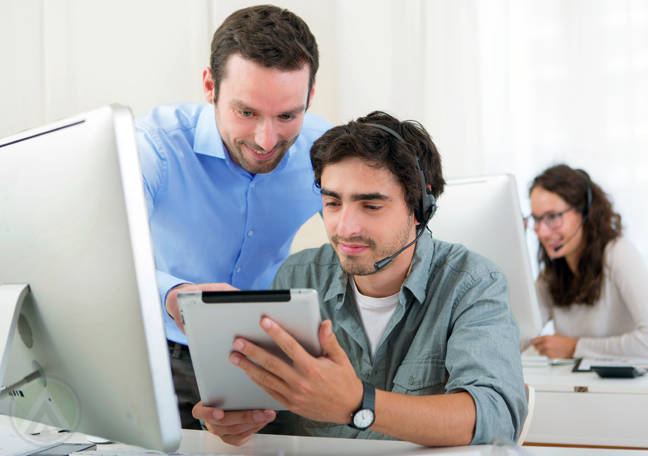 call center manager helping customer service agent use tablet
