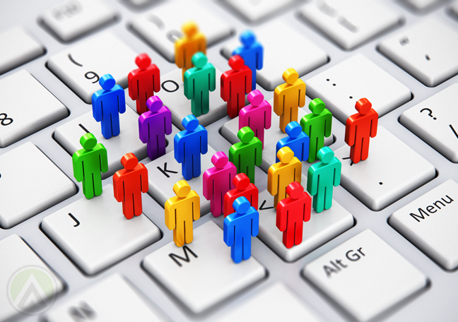 colorful human 3d figures standing on computer keyboard