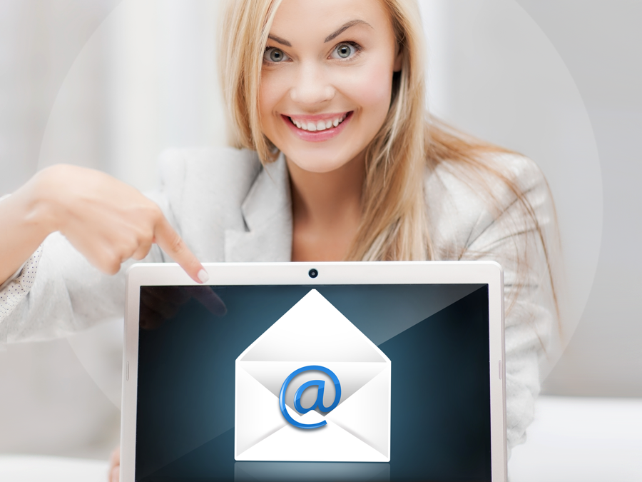 delighted email support agent pointing to email icon on laptop