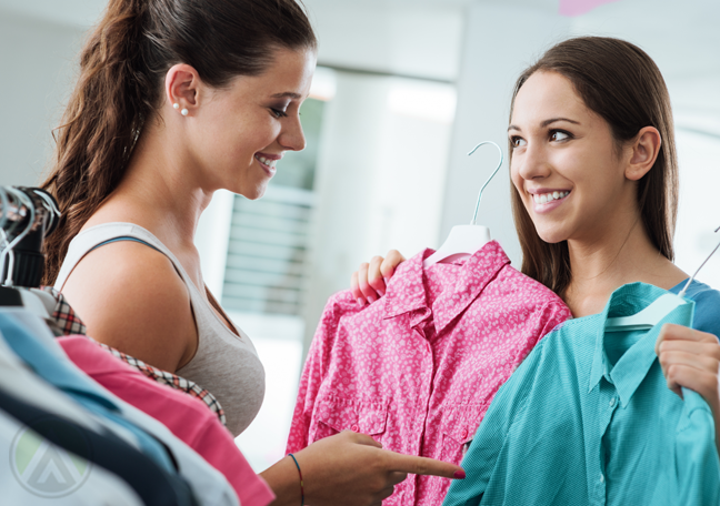 department store saleslady helping customer choose clothes