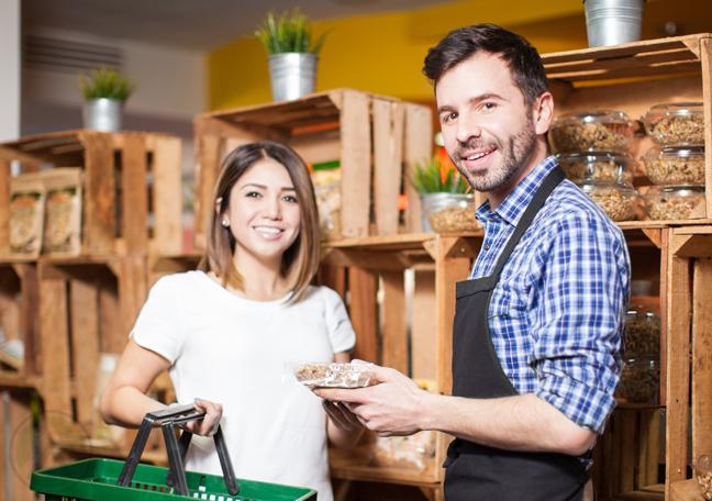 grocery shopkeeper assisting customer