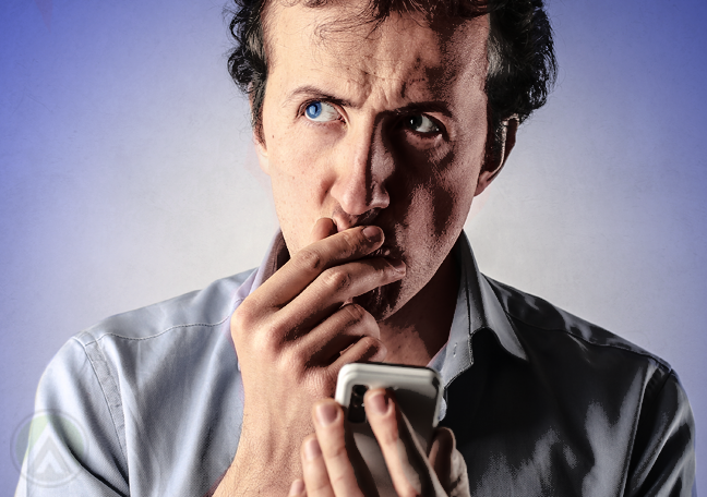 man holding smartphone thinking