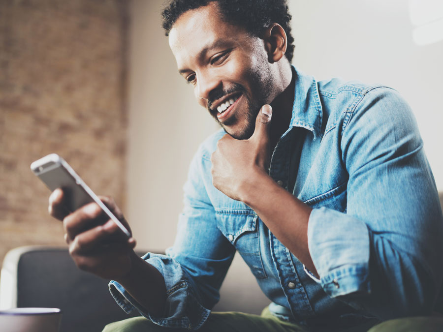 man making decisions using smartphone