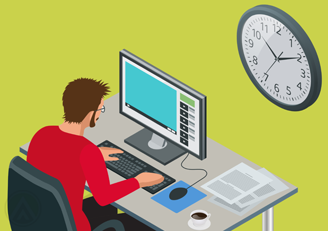 office employee using computer near wall clock