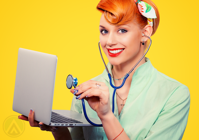red haired business executive in yellow holding stethoscope to laptop