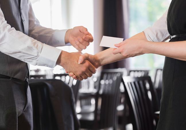 restaurant waitress giving customer business card