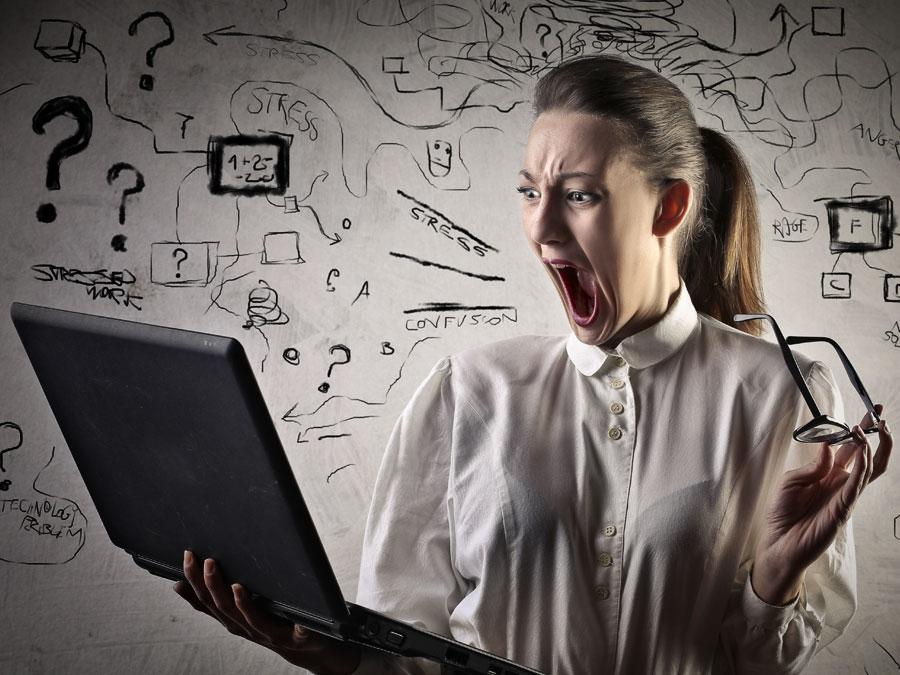 screaming employee using laptop