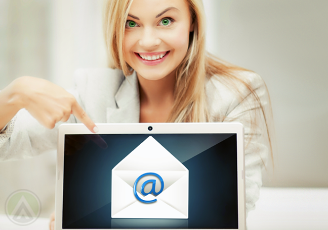 smiling-blonde-woman-pointing-to-tablet-with-at-sign