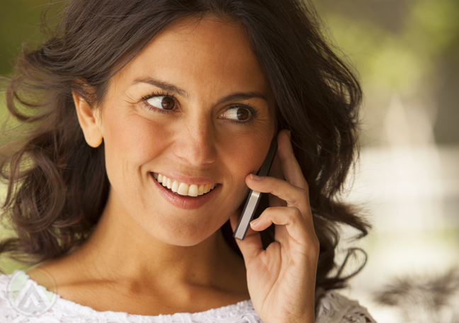 smiling woman in phone call