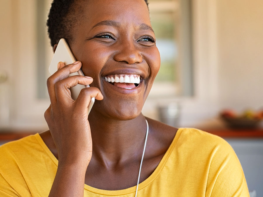 woman happily talking on phone