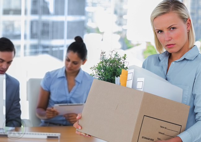 annoyed female employee walking out with office stuff
