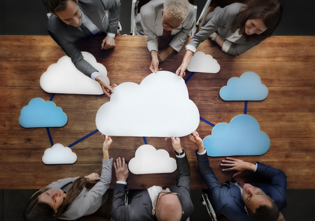 business team holding cloud on table