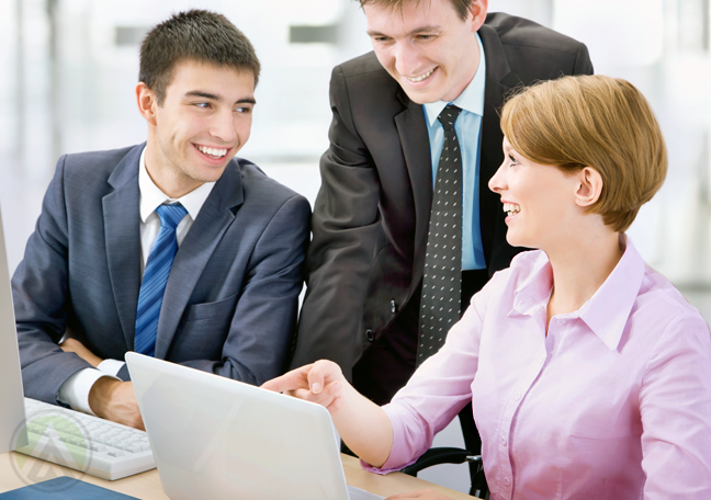 business team in meeting in front of laptop