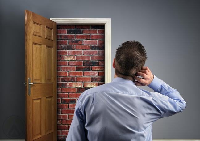 businessman trapped in room red bricks boarded up door