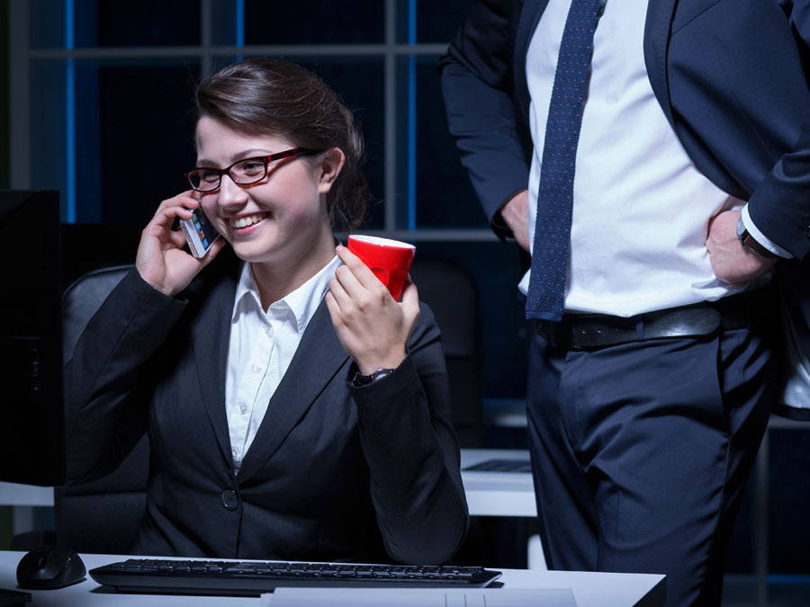 customer support agent in phone call holding red cup with boss hands on hips