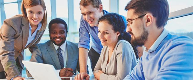 diverse business team meeting around laptop