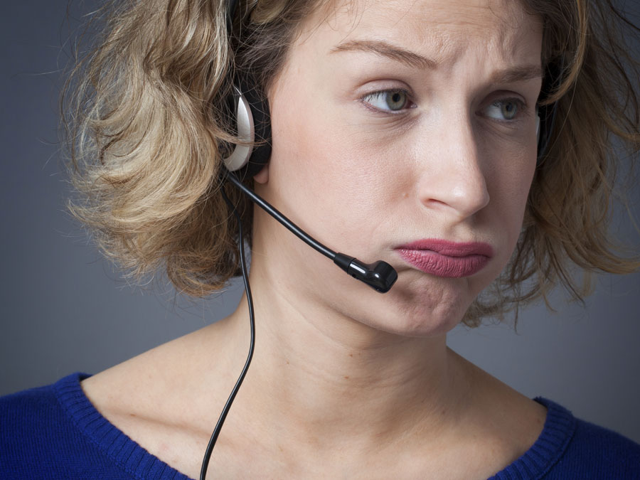 frustrated call center agent looking away
