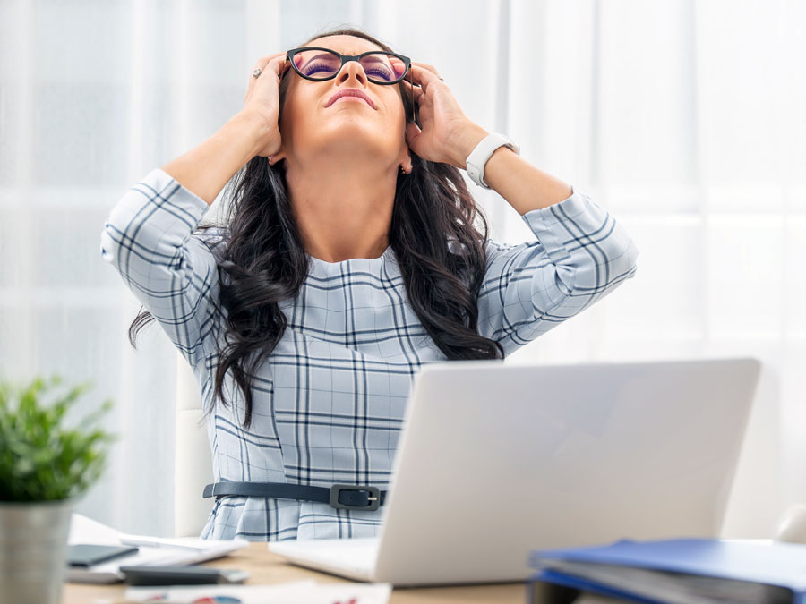 frustrated customer service agent holding head in headache