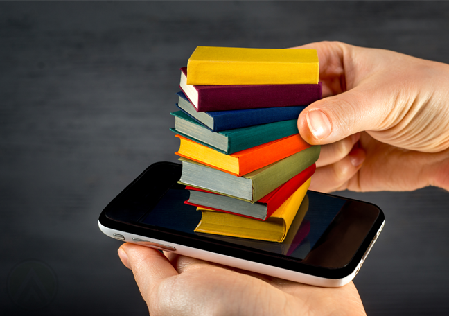 tiny books on top of smartphone