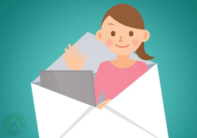 woman using laptop inside mail envelope