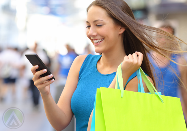 woman with shopping bags using smartphone mobile app