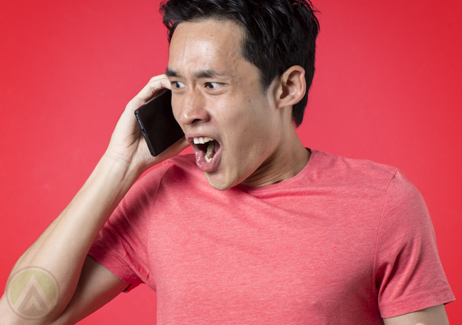 asian man frustrated with phone call