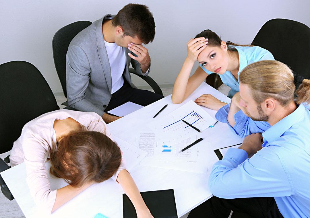 bored sleepy demotivated sad business team in a meeting
