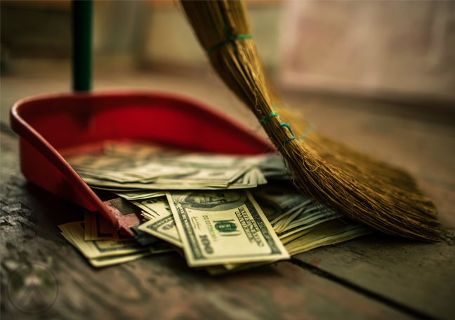 broom sweeping money cash into dust pan
