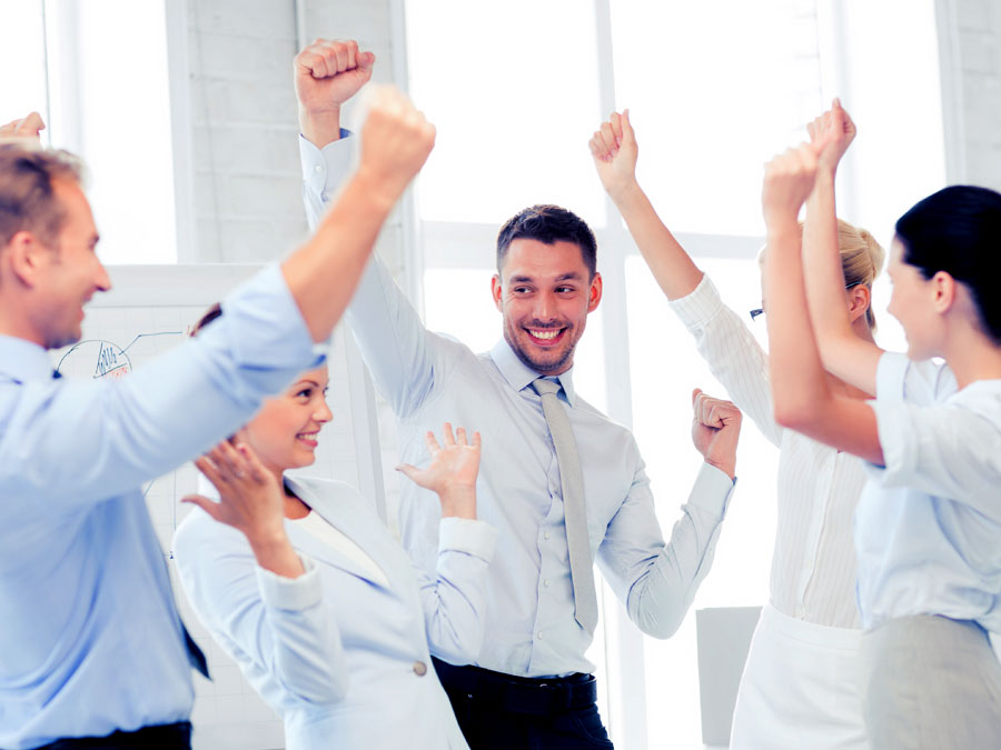 call center coworkers celebrating customer support score