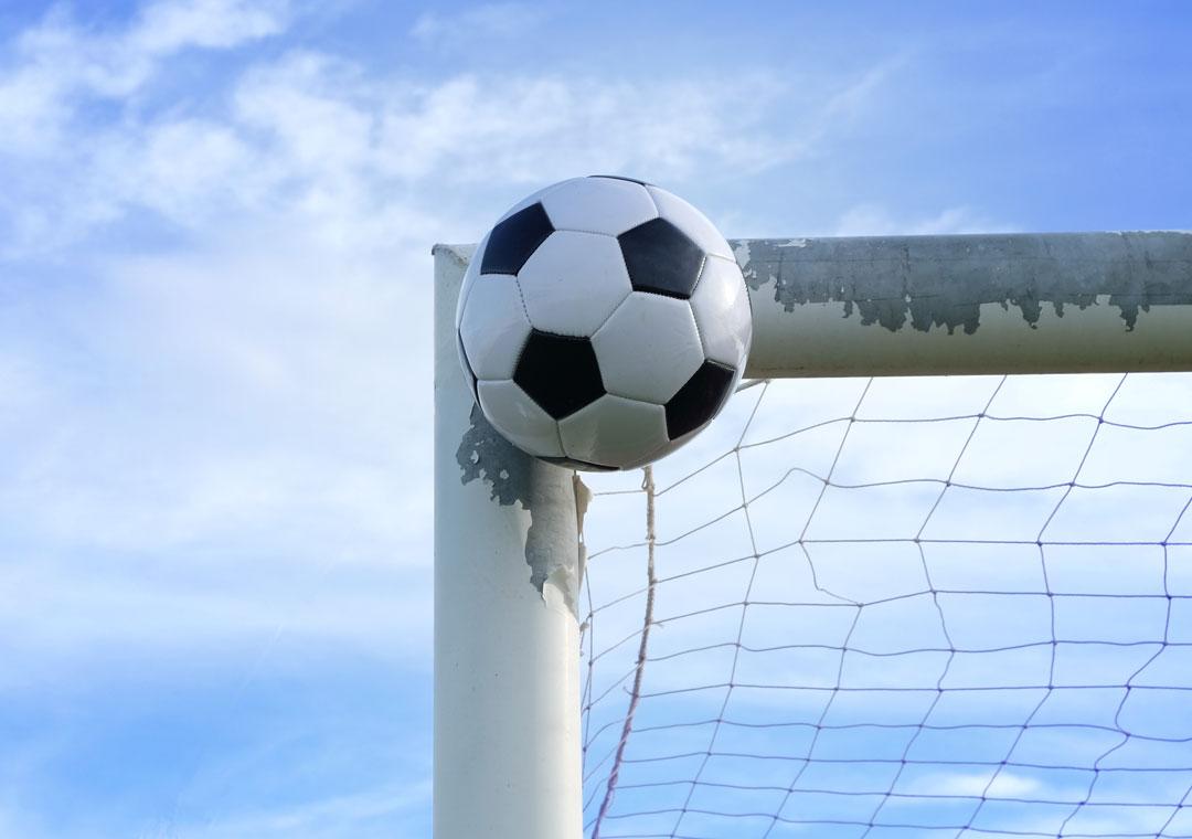 football soccer ball hitting goal metal frame