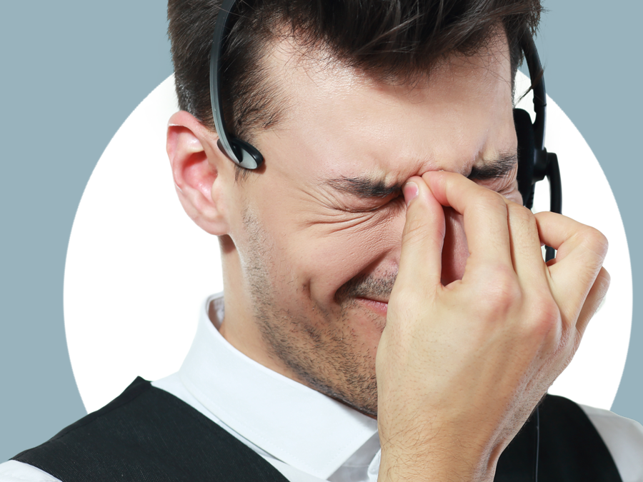 frustrated call center agent squinting