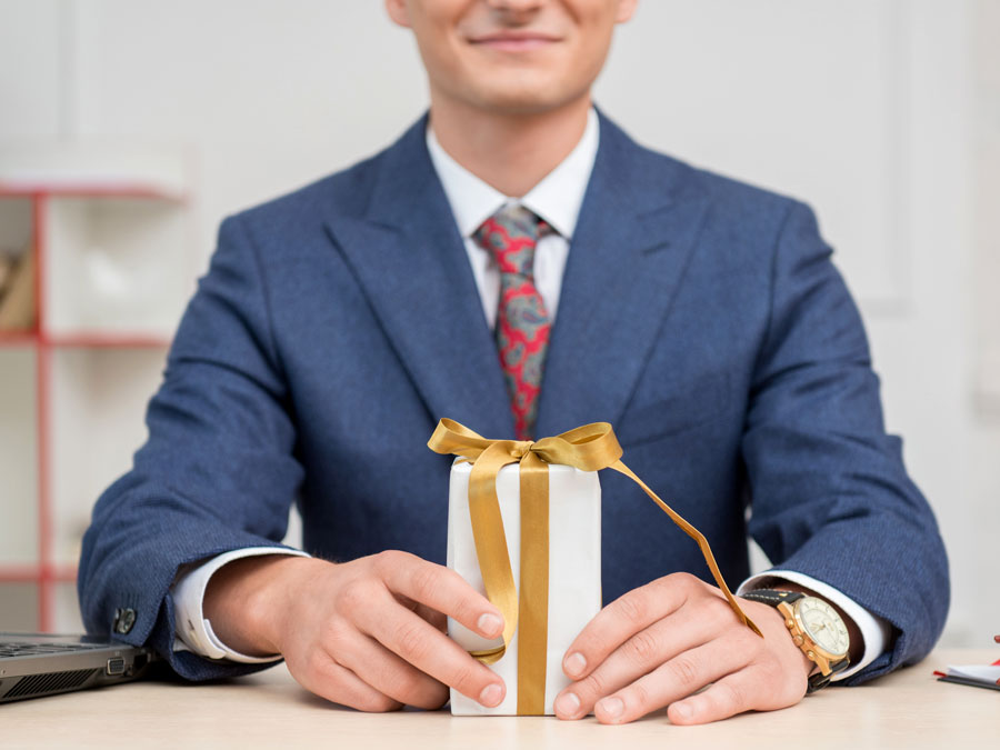 happy employee holding gift