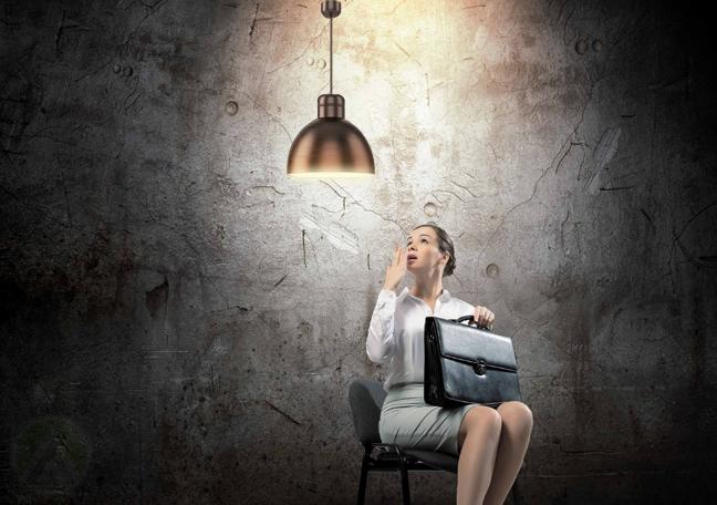 job applicant sitting in drark under light