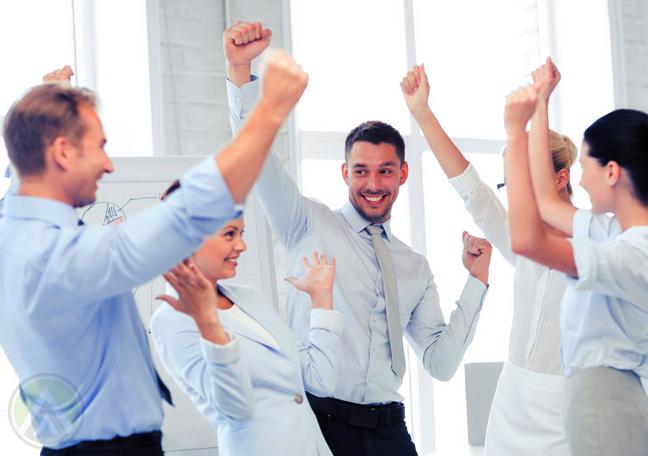 office coworkers dancing in office