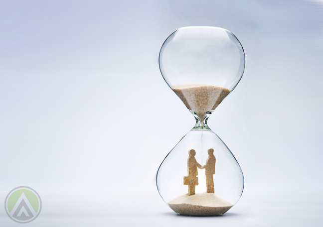 sand hourglass businessmen negotiating contract running out
