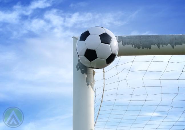 soccer ball hitting goal post