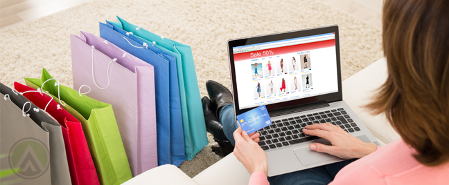 woman holding credit card using laptop online shopping