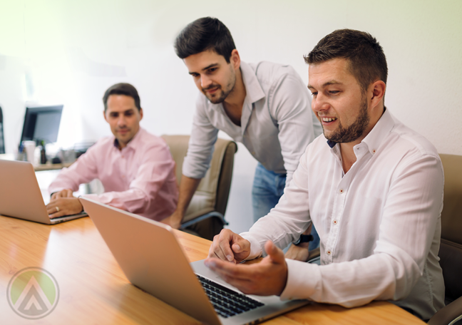 business team working on laptops on office conference room