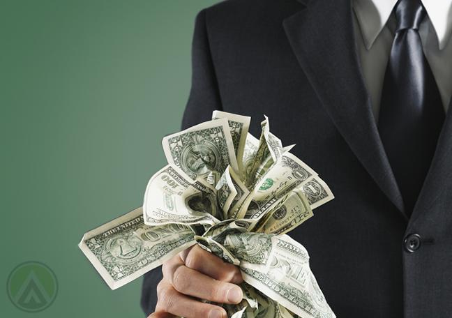 businessman holding money like a bouquet