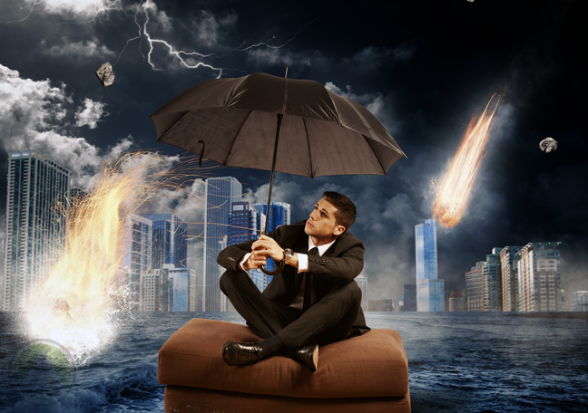businessman sitting on chair floating in flooded street with meteors