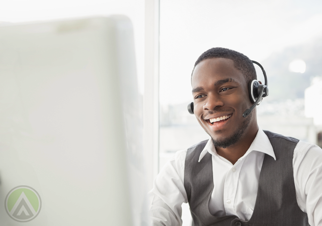 call center representative talking to customer in front of computer