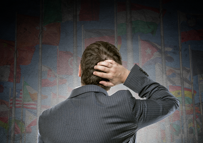 confused businessman back scratching looking up blurred dark maps of the nation