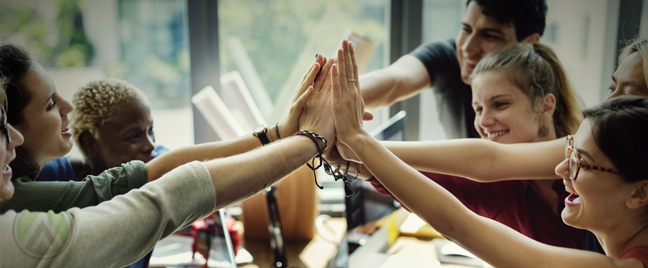 culturally diverse business team giving high five